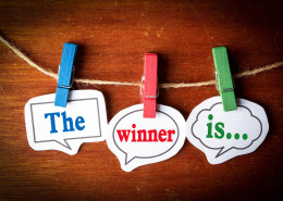 The winner is concept paper speech bubbles with line on the wooden background.